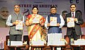 Ravi Shankar Prasad and the Union Minister for Textiles and Information & Broadcasting, Smt. Smriti Irani releasing the publication.jpg