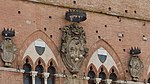 Reliefs of coats of arms-Palazzo Pubblico-Siena.jpg