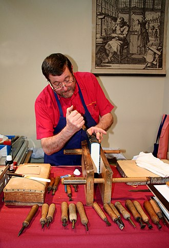 Bookbinding - A traditional bookbinder at work