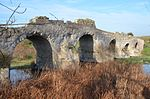 Roman bridge Ozieri, dating to the 2nd century AD and restored in the 3rd–4th century AD. It has six arcades for a total length of 87.50 metres (287 ft), Sardinia (16563701885).jpg