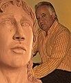 Roque Avila and his sculpture.jpg