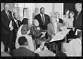 Rosa Parks at her Congressional Gold Medal ceremony seated with assistant Elaine Steele (left); President Bill Clinton, Representatives Dennis Hastert, Dick Gephardt and others stand behind them.jpg