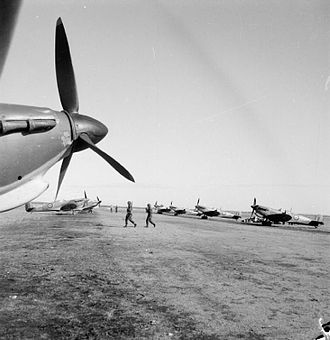 British airborne operations in North Africa - Supermarine Spitfire Mark Vs, reinforcement aircraft for North African units, lined up at Bone airfield, Algeria.