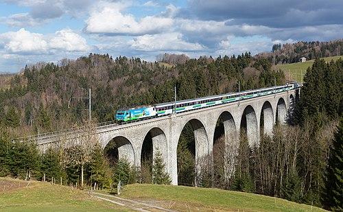 Voralpenexpress cross the Wissbach viaduct near Degersheim