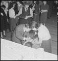 San Francisco, California. As a safeguard for health, evacuees of Japanese descent were inoculated . . . - NARA - 536397.tif