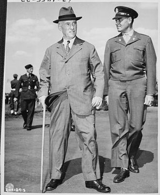 Henry L. Stimson - Stimson and Colonel William H. Kyle (right) arrive at the Gatow Airport in Berlin, Germany to attend the Potsdam Conference (July 16, 1945).
