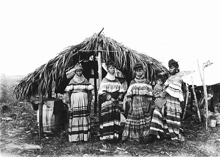 Seminole family of tribal elder, Cypress Tiger, at their camp near Kendall, Florida, 1916. Photo taken by botanist, John Kunkel Small Seminole family Cypress Tiger.jpg