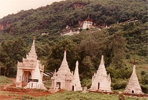 Pindaya Caves - Shwe U Min Pagoda and Pindaya Caves from the foot of the hill