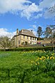 Snowshill Manor with Daffodils - Low view from the Orchard - panoramio.jpg