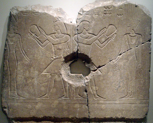 Sobekhotep III - Sobekhotep III worshipping Satet. The central hole was made when the relief was used as a grinding stone, long after the original carving. Now on display at the Brooklyn Museum.