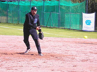 Fastpitch softball - A Danish pitcher demonstrates the underhand release of the ball.