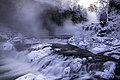 Steam rises from Willow Falls in subzero temperatures at Willow River State Park in Hudson, Wisconsin - 49206483337.jpg
