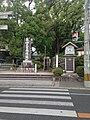 Stele for Emperor Ojin and clock in Umi Hachiman Shrine.jpg