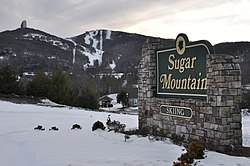 Sugar Mountain Sign and Mountain in Background