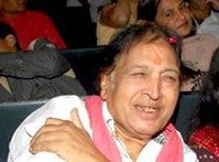 Image of Ustad Sultan Khan sitting and smiling