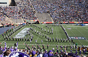 "Northwestern Wildcats - The Northwestern University ""Wildcat"" Marching Band forms the ""Sculpted N"" and performs ""Go U Northwestern!"" to close its pregame performance at the 2005 Sun Bowl under the direction of Daniel J. Farris."