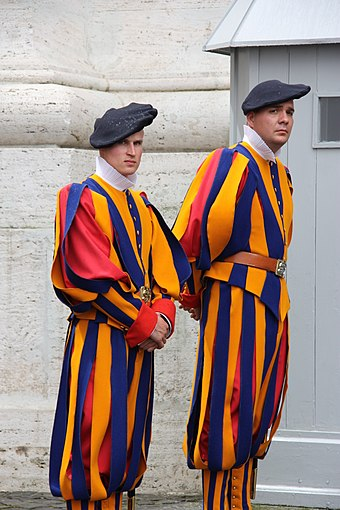 Tricolor full dress uniform worn with black beret. Swiss guards in the Vatican City, 2010.jpg