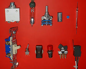 Switch - Electrical switches. Top, left to right: circuit breaker, mercury switch, wafer switch, DIP switch, surface mount switch, reed switch. Bottom, left to right: wall switch (U.S. style), miniature toggle switch, in‑line switch, push-button switch, rocker switch, microswitch.