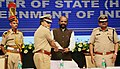 """The Delhi Police Commissioner, Shri Amulya Patnaik presenting a memento to the Minister of State for Home Affairs, Shri Hansraj Gangaram Ahir, during the """"Cyber Safety and Digital awareness programme for senior citizens"""".JPG"""