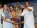 The Minister of State (Independent Charge) for Consumer Affairs, Food and Public Distribution, Professor K.V. Thomas presenting the trophy to Divya Rawat, at the 'Hum Kishore Festival', festival of school children.jpg