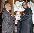 The President, Shri Pranab Mukherjee presenting the Padma Shri Award to Prof. (Dr.) Thenumgal Poulose Jacob, at an Investiture Ceremony-II, at Rashtrapati Bhavan, in New Delhi on April 26, 2014.jpg