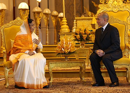 King Norodom Sihamoni hosting Indian President Pratibha Patil in 2010. The President, Smt. Pratibha Devisingh Patil meeting the King of Cambodia, HM Preah Bat Samdech Preah Boromneath Norodom Sihamoni, at Thrown Hall, in Royal Palace at Phnom Penh, Cambodia on September 14, 2010.jpg