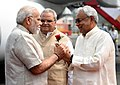 The Prime Minister, Shri Narendra Modi being received by the Governor of Bihar, Shri Satya Pal Malik and the Chief Minister of Bihar, Shri Nitish Kumar, on his arrival, at Patna, Bihar on April 10, 2018.jpg