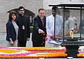 The Prime Minister of New Zealand, Mr. John Key paying floral tributes at the Samadhi of Mahatma Gandhi, at Rajghat, in Delhi on June 28, 2011. Mrs. Bronagh Key is also seen.jpg