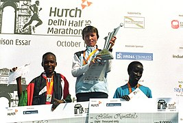 The Winners of the Delhi Half Marathon, Phillip Rugut of Kenya (Men) and Irina Timofeyeva of Russia (women) on the podium after the race, in New Delhi on October 16, 2005.jpg