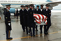 The body of Army LCOL Charles Ray is being carried from a VC-137 Stratoliner aircraft upon arrival. Ray was killed by terrorists in Paris DF-SC-83-06138.jpg