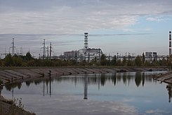 The damaged unit 4 reactor and shelter at Chernobyl (02710141).jpg