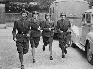 American Ambulance Great Britain - Members of the American Ambulance, Great Britain, run to their vehicles