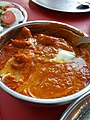 Their house specialty is butter chicken, which some call chicken tikka masala (44272498831).jpg