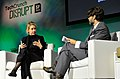 Theranos Chairman, CEO and Founder Elizabeth Holmes (L) and TechCrunch Writer and Moderator Jonathan Shieber speak onstage at TechCrunch Disrupt at Pier 48 on September 8, 2014 (14995888227).jpg
