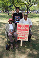 Three marchers with original sign and commemorative t-shirt - 50th Anniversary of the March on Washington for Jobs and Freedom.jpg