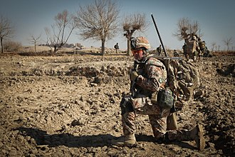 Royal Danish Army - A Danish soldier surveys the Afghan plains while halted during a foot patrol in the district of Nahr-e Saraj, Helmand Province, Afghanistan on January 6, 2012.