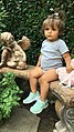 Toddler sitting on a bench.jpg