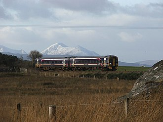 Kyle of Lochalsh line - The view from Duirinish. Skye can be seen in the background with a covering of snow.