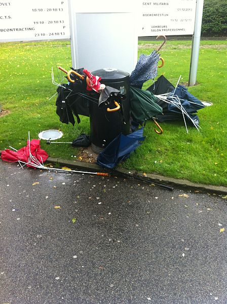 A big number of umbrellas thrown away by their owners because of heavy wind damage.