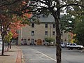 Tree lined view of Mendon Town Hall, Village of Honeoye Falls.jpg