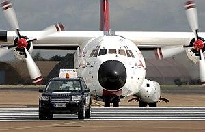 Aircraft marshalling - Turkish Air Force Transall C-160D behind the Follow-me car at RIAT, England.