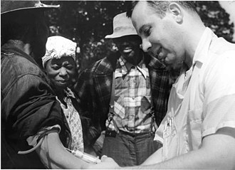 Tuskegee syphilis experiment - A doctor draws blood from one of the Tuskegee test subjects.