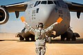U.S. Air Force Senior Airman Douglas Prewitt, with the 621st Contingency Response Wing, marshals a C-17 Globemaster III aircraft at Geronimo Landing Zone during the Joint Readiness Training Center 14-03 field 140116-F-XL333-030.jpg