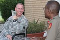 U.S. Army Command Sgt. Maj. Ronnie R. Kelley, left, the senior enlisted adviser of U.S. Army Central Coalition Forces Land Component Command, visits with the commandant of the Kuwait Ministry of Defense 140827-A-DO086-064.jpg