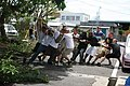U.S. Marines, with Engineer Maintenance Company, 3rd Maintenance Battalion, 3rd Marine Logistics Group, III Marine Expeditionary Force, take down a tree at Takahara Elementary School in Okinawa City, Japan 110701-M-PH080-163.jpg