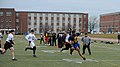 U.S. Navy Lt. Cmdr. Alex Hampton, front right, a student at the U.S. Naval War College (NWC), scrambles for a first down during an Army-Navy flag football game at Nimitz Field at Naval Station Newport 131206-N-PX557-155.jpg
