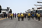 U.S. Sailors and Marines look for debris aboard the amphibious assault ship USS Kearsarge (LHD 3) in the Gulf of Aden Aug. 6, 2013 130806-N-RL456-035.jpg