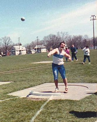 Buffalo Bulls - UB Men's Track Team Member Performing Shot Put at NCAA Championships, Springfield, MA, 1990