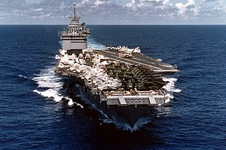 USS Enterprise (CVN-65) - Enterprise en route back to the United States following the evacuation of Saigon; the forward end of the flight deck contains a number of USMC CH-53 Sea Stallion helicopters.