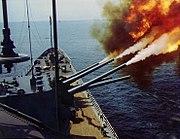 USS Saint Paul (CA-73) provides gunfire support off South Vietnam, circa in October 1966 (80-G-K-33437)